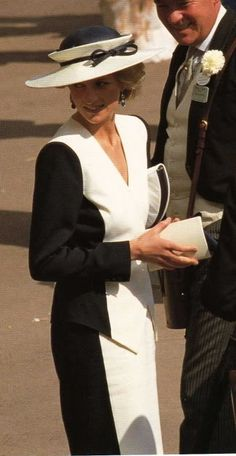 Diana in a black and white ensemble. Very unusual crown on her hat. (not wearing a necklace so it is a different time)