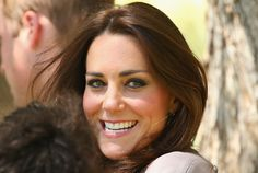Catherine, Duchess of Cambridge smiles as she arrives at the National Indigenous Training Academy on April 22, 2014 in Ayers Rock, Australia. The Duke and Duchess of Cambridge are on a three-week tour of Australia and New Zealand, the first official trip overseas with their son, Prince George of Cambridge.
