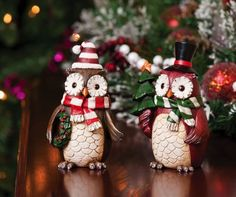 """Decorative Christmas Owls -2 Asst. by Peachy Kitchen. Save 29 Off!. $33.99. 5"""" L x 3.25"""" W x 7"""" H. Resin. Multi-colored. Fun seasonal accent pieces. 2 Assorted. As if they are caroling door to door, these cheerful owls are whimsical celebrations of the season. Dressed for winter with their long striped scarves and warm hats, they come bearing gifts of a wreath and tiny Christmas tree. They are sure to bring a smile to the face of every guest who stops by. Making festive add..."""