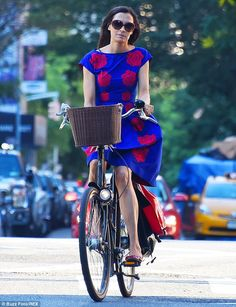 Romantic date: Famke went for a bike ride with her boyfriend actor-producer boyfriend Cole on Saturday