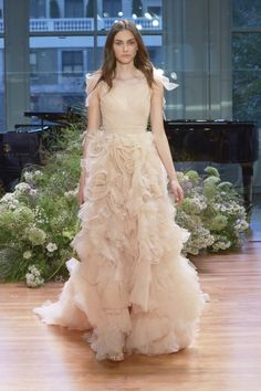 Are you considering a blush wedding dress? We have selected 12 stunning and romantic blush bridal gowns that are a great choice for an outdoor wedding. #blushweddingdresses #blushbridalgowns