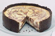 This simple cheesecake looks sensational with creamy swirls of chocolate.