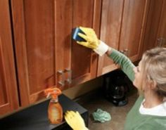"""How to Clean Kitchen Cabinets. Note the comment about heating the sponges first. Also, if you want to sanitize your sponges like I do every few days, pop a damp one into the microwave for 3 minutes. When they are finished """"cooking"""" they will be germ free."""