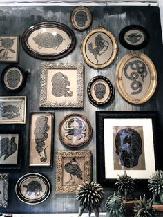 A wall of wild and crazy framed prints - a fun way to display a curious collection!