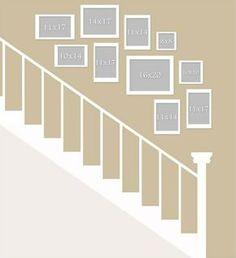 Bilder an der Wand im Treppenhaus aufhängen