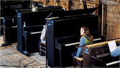 """Case and her """"strays"""" — a half-dozen pianos in varying degrees of disrepair that she has collected — in her Vermont barn during the recording of her latest record, """"Middle Cyclone."""""""