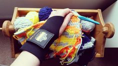 nailyaplaskeydesigns:- This antique wooden doll cradle holds my blanket in progress and this Ergodyne glove holds my wrist. What do you do for wrist pain besides taking breaks and stretching? Have you tried any products such as oils or balms?