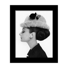 84cbcf1fe8e33 Audrey Hepburn Wearing A Givenchy Hat Framed Print by Cecil Beaton