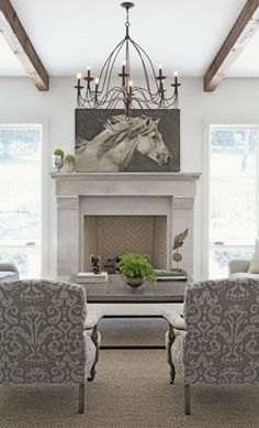 Love the herringbone fireplace. The chairs & equine art are pretty sweet also   Equestrian interior design : Equestrian Chic