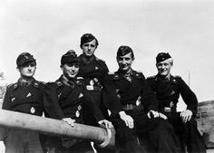 Hauptmann Friedrich Karl Nökel (second from right) photographed in October 1944 with his Panzer IV crew. He was awarded the Knight's Cross on 17 September 1944 for destroying 11 Soviet tanks in one...