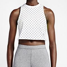 Nike Track & Field Cropped Tank Top Nike Track & Field Cropped Tank Top. White with Black Dots. Brand new with tags. No trades. Nike Tops Crop Tops