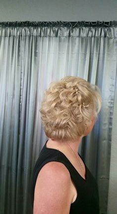 Hair style up do for the mother of the bride, done by Hair by Melony Terry