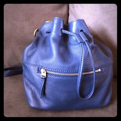 Fossil genuine leather bucket/cross body handbag Heritage blue, leather Fossil drawstring bucket bag with long strap to wear hands-free crossbody. Worn only a few times, excellent condition. No visible wear. Fossil Bags Crossbody Bags