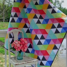 "Do you know someone who deserves a Serenade?  Size: 60"" x 68""  Fat Quarter Friendly!  This pattern uses the Creative Grids® 60 Degree Triangle Ruler ( #CGRT60 ). @creativegridsusa  #quilt  #triangles #bright"