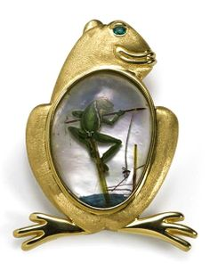 A reverse painted rock crystal and tourmaline frog brooch with emerald eye, Sandrajean Wainwright