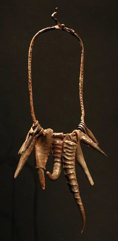 West Africa | Iron, goat and gazelle horn talismans on a fiber and leather necklace