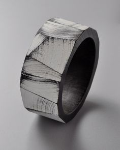 By Julia Turner, Bracelet #1 (Black/White), Ebonized Walnut, enamel paint.