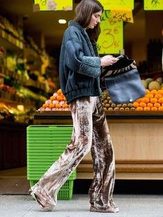 Be on-trend yet cozy for winter with a shearling jacket, velvet flare trousers and a leopard clutch