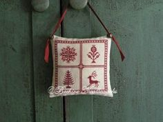 Holly Trevelyan Christmas Pillow by Beehive Needleworks will finish nicely as a pillow as featured in this picture. It shows a reindeer, hol...