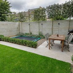Family garden design in Barnes West London, lawn space as possible for various play activities and an intimate dining area with pleached Quercus Ilex trees Back Garden Design, Backyard Garden Design, Backyard Landscaping, Terrace Design, Backyard Ideas, Back Gardens, Small Gardens, Outdoor Gardens, West London
