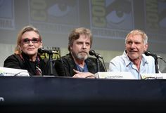 """Carrie Fisher Photos Photos - (L-R) Actors Carrie Fisher, Mark Hamill and Harrison Ford at the Hall H Panel for """"Star Wars: The Force Awakens"""" during Comic-Con International 2015 at the San Diego Convention Center on July 10, 2015 in San Diego, California. - Star Wars: The Force Awakens Panel at San Diego Comic Con - Comic-Con International 2015"""