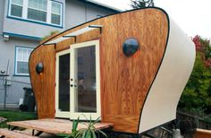 A tiny house is a small home usually square feet for one or two people. The small house lets people live debt free, have simple lives and the can travel with their tiny house on wheels if they want Portable Sheds, Office Pods, Backyard Office, Backyard Ideas, Home Office Furniture, Smart Furniture, Shed Plans, Sustainable Design, Sustainable Development