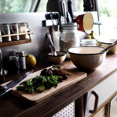 Interior design for a DIY campervan conversion !  The van countertop for our kitchen is now scratched and used, and we love it ! Cooking in a van is made easy with good design , tools and good food