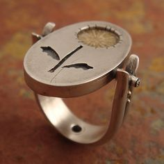 dandelion-- a flip-top ring by downtothewiredesigns, via Flickr