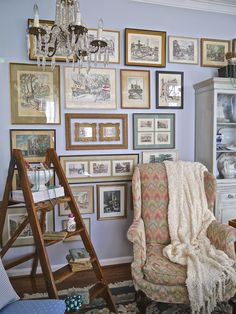 Beautiful display of prints and frames, ladder. Christmas (Chateau Chic: Home Tours)
