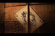 Available Only in the Prohibition Boxed SetDisparos - Spanish for 'shots', is how tequila should be consumed. Taking inspiration from the vaqueros and gunslingers of the Mexican old west, the tequila deck is a piece of history.   The block printing design and false-edge border gives these cards a rustic look, the kind you'd expect to find regularly laying about on a three-legged wood table in the local cantina, stained with condensation rings from the cold tequila glasses.  No detail has…