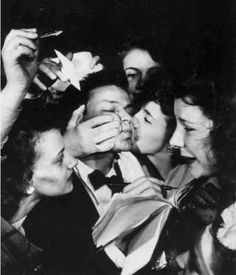 Frank Sinatra and his Fans all swooning and kissing him