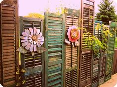 Fence made of assortd old shutters: 26 Surprisingly Amazing Fence Ideas You Never Thought Of