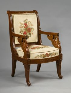"""One of a set of four French Empire period, mahogany and mahogany veneer fauteuils. The arms rest on carved winged swan necks. Paris, 1810-20. The fauteuils are stamped, """"L. BELLANGE"""", by their maker Louis-François Bellangé (1759-1827)."""