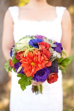 Lots of vivid colors going on at this wedding! Photography by Matthew Johnson Studios, Floral Design by Wow Factor Floral.