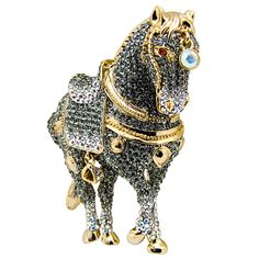 Butler & Wilson Crystal Saddled Horse Brooch featuring Swarovski crystal, it fastens with a post pin and revolver clasp.