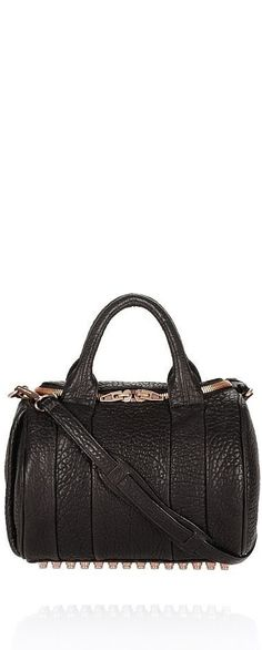 You, Scorpio, are walking proof that black is never boring. Though you prefer dark colors since they blend in so well with your signature style, you're not afraid of a little edge. The Alexander Wang Rockie bag ($850) is right up your alley.
