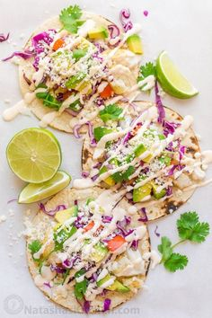 Our go-to fish tacos recipe for entertaining! Easy, excellent fish tacos with the best fish taco sauce; an irresistible lime crema!   natashaskitchen.com