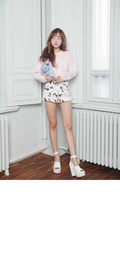High-Rise Feminine Shorts With Floral Prints With a White Sweater and White Platform Heels