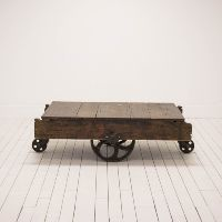 Rustic Factory Cart Coffee Table l Wood Table with Wheels l Bohemian Floor Seating Around Coffee Table l Birch & Brass Vintage Rentals l Weddings and Corporate Events l Austin, Texas