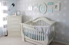 Our little man's nursery is simple, clean and fun mixing and matching different patterns… polka dots, stripes and chevron.