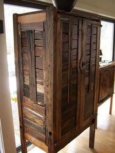 Awesome recycled wood armoire