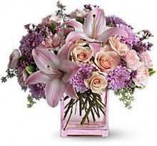 peach roses, pink asiatic lilies, pink carnations, lavender cushion mums and lavender waxflower.  Cushion mums.