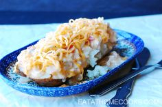 Slow Cooker King Ranch Chicken over Baked Potatoes