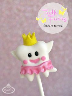 Follow this tutorial to learn how to make an adorable tooth fairy fondant cupcake topper sure to bring a gap-toothed smile to a child's face.
