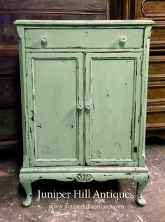 Heavily distressed, we have painted this 1930s mini bar a luscious shade of green glazed with dark and clear wax.