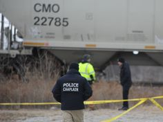 Am Ames police chaplain walks to the scene where a man was struck and killed by a train near North Dakota Street in Ames on Friday, Jan 13, 2017, in Ames, Iowa. Photo by Nirmalendu Majumdar/Ames Tribune http://www.amestrib.com/news/20170113/one-person-dead-after-being-struck-by-train