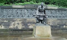 """Scottish-American War Memorial with a text by Ewart Alan Mackintosh. This memorial, """"The Call"""", was erected in Princes Street Gardens in 1927, gifted by American Scots as a tribute to the bravery of troops during the 1914-1918 conflict. Mackintosh's text reads """"if it be life that waits, I shall live forever unconquered. If death, I shall die at last, strong in my pride and free."""""""