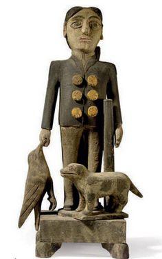 Folk art sculpture - man with dog.