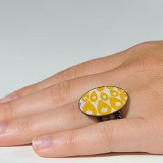 Fabric Ring with a mustard peacock print