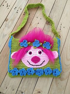 This pattern is for a troll book bag for a child. The strap can be increased or decreased in size depending on the desired fit. The bag fits a coloring book sized book.